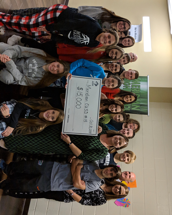 MHS Entrepreneurship and Foods III/IV accept their grant from ADM Cares.