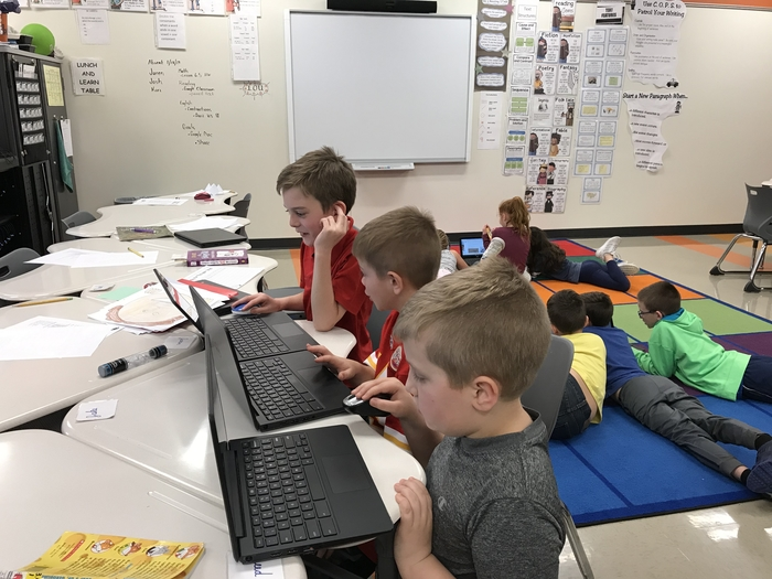 Alex, Jake, Rylin are researching Super Bowl history.