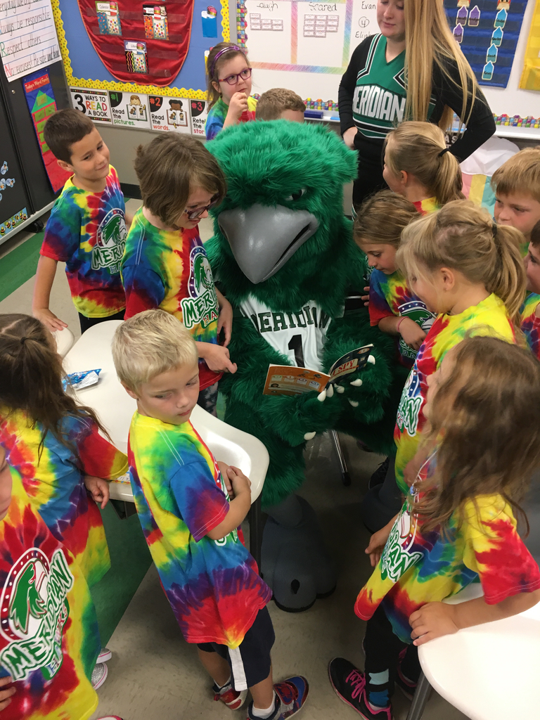 The Meridian Hawk loves reading with First Graders!