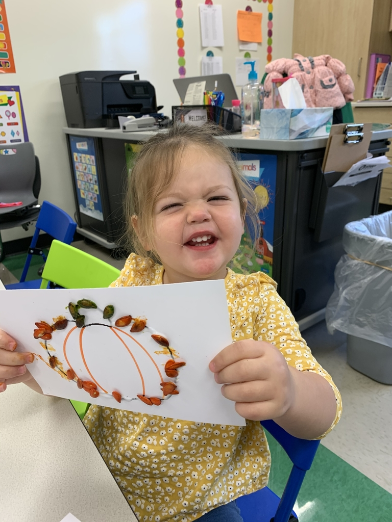 A cute little pumpkin and her pumpkin seed artwork!